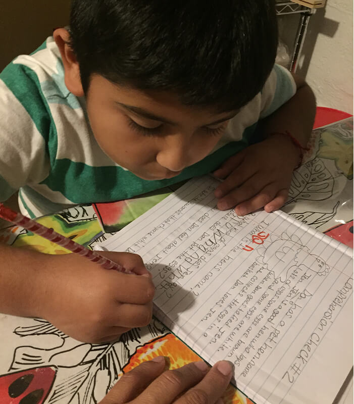 image of boy writing